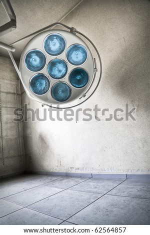 An abstract image of a surgical lamp at an abandoned hospital - stock photo