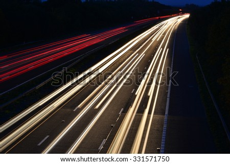 An Abstract light view of traffic on the M23 near London, Gatwick  at dusk in Autumn/Fall. - stock photo