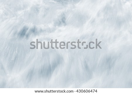 An abstract, long exposure of whitewater resulting from breaking ocean waves.