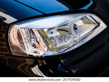 An abstract macro shot of a car headlight. - stock photo