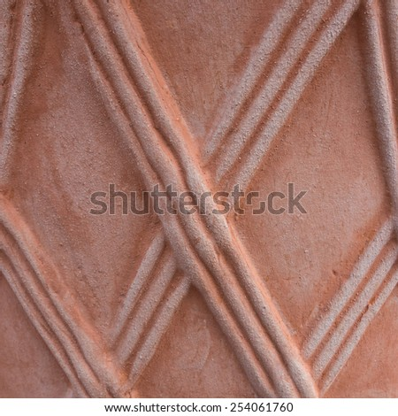 An abstract macro shot of the side of a terracotta pot. - stock photo