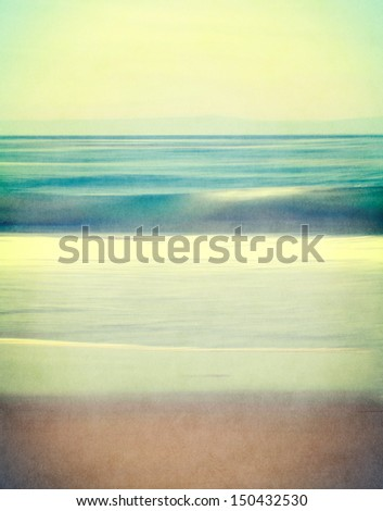 An abstract ocean seascape with blurred panning motion.  Image displays a retro, vintage look with cross-processed colors and a finely textured paper grain. - stock photo