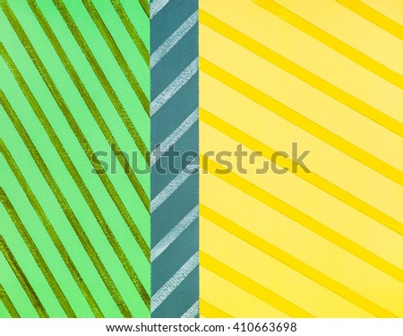An abstract painting; 3 bands of colourful crosshatching. - stock photo