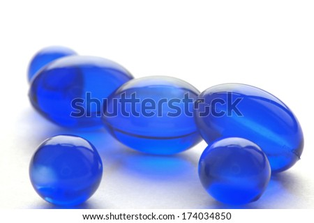 An abstract picture of vitamins pills in blue color