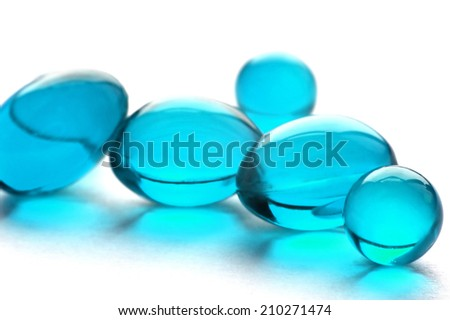 An abstract picture of vitamins pills in cyan color - stock photo