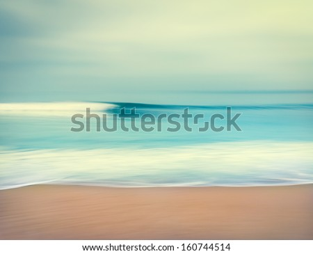 An abstract seascape with blurred panning motion.  Image displays a retro, vintage look with cross-processed colors. - stock photo
