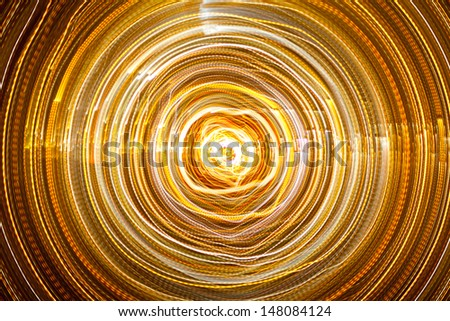 An abstract shot of city lights on a long exposure.  Gives the impression of looking into a tunnel. - stock photo
