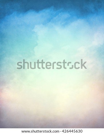 An abstraction of clouds and fog on a textured background with a multi-colored gradient.  Image displays a distinct paper grain and texture at 100 percent.