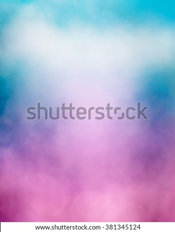An abstraction of clouds and fog with a purple to blue gradient and subtle bokeh light effects.  Image is soft focus. - stock photo