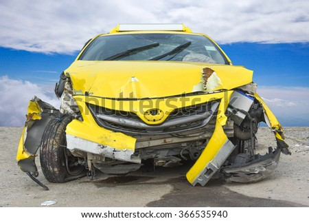 An accident with a black car isolated on white, yellow limousine was hit and dented  - stock photo