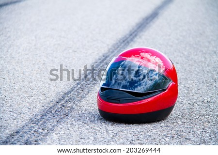 an accident with a motorcycle. traffic accident and skid marks on road. symbol photo. - stock photo