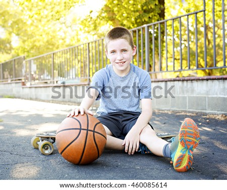 An active kid with a basketball - stock photo