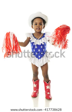 An adorable African American happy in her western, star studded red, white and blue outfit gently shaking her pom-poms.  On a white background. - stock photo