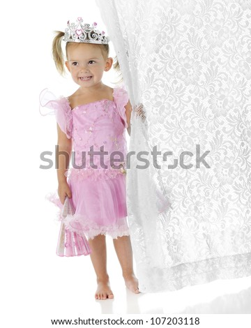 "An adorable barefoot preschool ""princess"" holding a fan in one hand while clutching a lacy white curtain in the others.  On a white background. - stock photo"