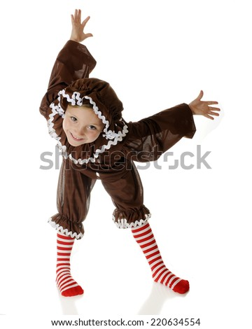 """An adorable """"gingerbread girl"""" happily dancing, with her body in contortions.  On a white background. - stock photo"""
