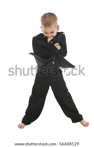 An adorable little boy in the studio wearing a rockstar outfit and pretending to do a performance. - stock photo