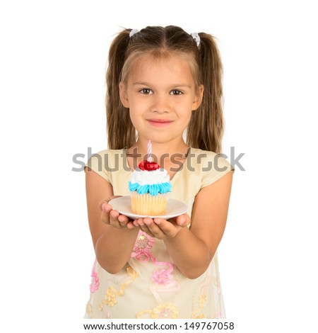 An adorable little girl holds a cupcake with a small anniversary candle, isolated - stock photo