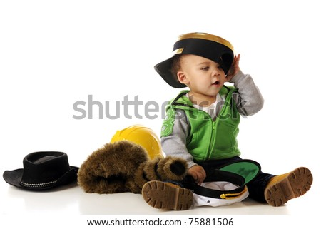 An adorable mixed-race baby trying on a many different style hats.  Isolated on white. - stock photo