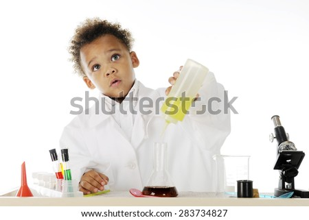 "An adorable preschool ""chemist"" looking up concerned as he's mixing oil into a dark water-based liquid.  On a white background."