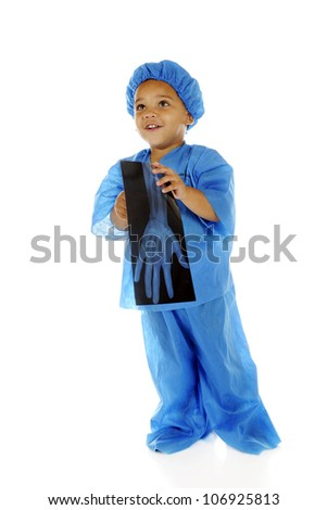 "An adorable preschool ""doctor"" happily looking up while holding an x-ray of an intact hand.  On a white background."