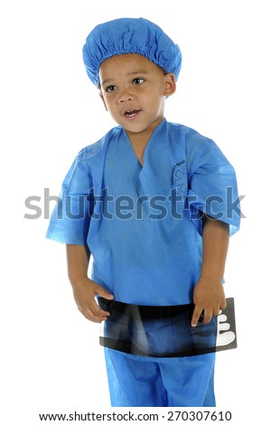"An adorable preschool ""doctor"" in ER scrubs, explaining a troublesome spot on an x-ray of a foot.  On a white background."