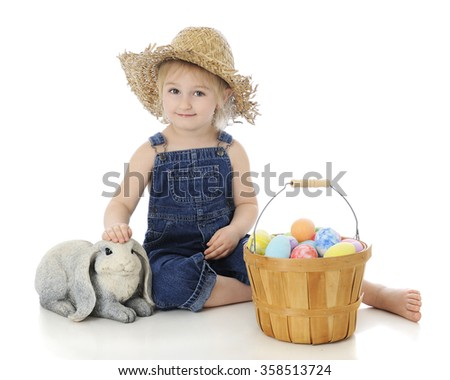 "An adorable preschool ""farm girl"" happily petting a bunny with a fruit basket full of colorful eggs.  On a white background."