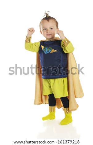 An adorable preschool superhero happily flexing his muscles.  On a white background. - stock photo