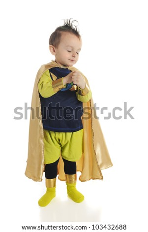 "An adorable preschool ""superhero"" with his eyes closed and hands folded in prayer.  On a white background. - stock photo"