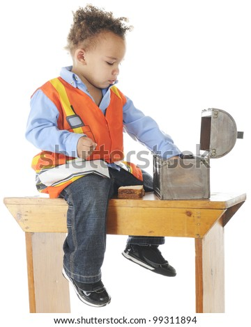 "An adorable preschooler ""construction worker"" having lunch on an old bench.  On a white background."