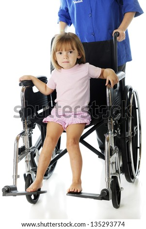 an adorable preschooler riding in a big wheelchair that's being pushed by a volunteer.  On a white background. - stock photo