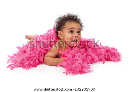 An adorable six month old baby girl laying against a white background wrapped in a pink feather boa - stock photo