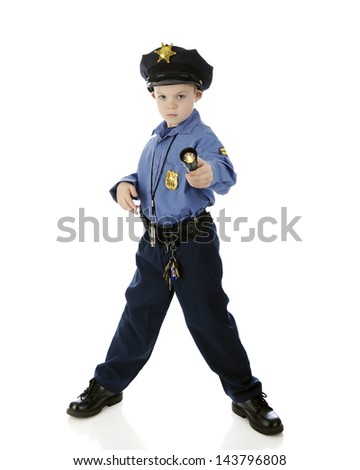 An adorable young boy seriously pointing his flashlight at the viewer while wearing a policeman uniform.  On a white background. - stock photo