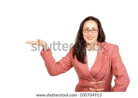 An adult businesswoman wearing a suite on a isolated white background holding a product with upturned hand