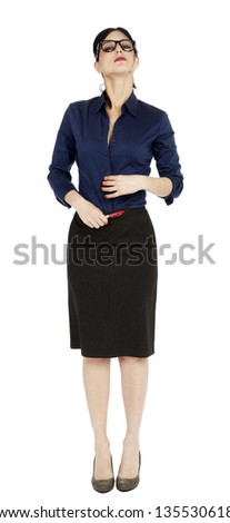 An adult (early 30's) woman glancing at the camera from above, as her neck is stretched and her chin lifted. Seems she's processing a thought. Isolated on white background. - stock photo