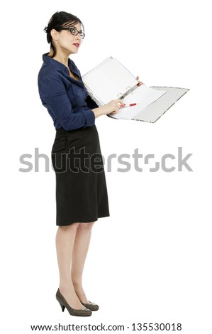 An adult (early 30's) woman holding a ring binder folder and pointing with her pen to a certain detail in the document while glancing up, as if contemplating the subject. Isolated on white background - stock photo