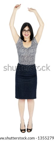 An adult (early 30's) woman looking at the camera with a large toothy smile while raising her arms up high. She is very satisfied by success. Isolated on white background. - stock photo