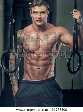 An adult muscled man in black pants - stock photo
