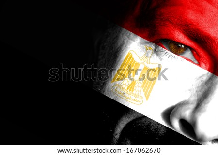 An adult sports fan with his face painted in the colors of Egypt's flag - stock photo
