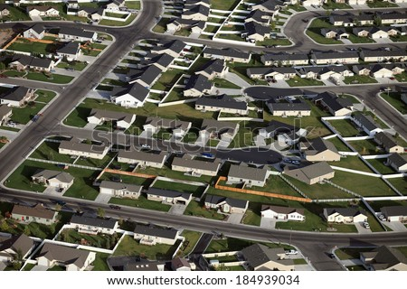 An aerial view of a modern housing subdivision - stock photo