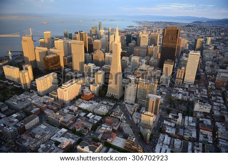 an aerial view of downtown san francisco during sunset