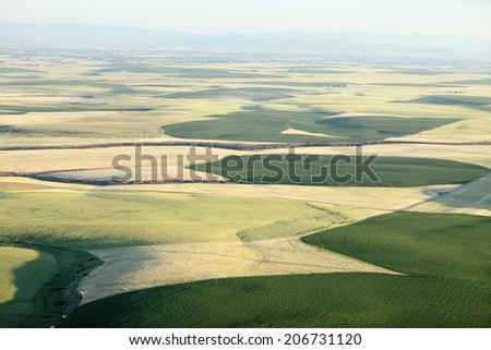 An aerial view of farm fields ready for harvest - stock photo