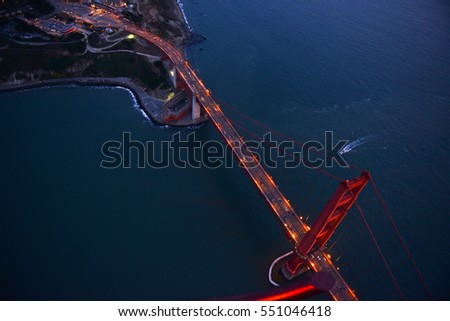 an aerial view of golden gate bridge in san francisco during sunset, taken from a helicopter
