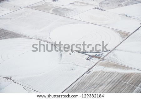 An aerial view of irrigated cropland in the winter with circles - stock photo