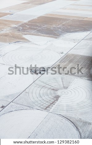 An aerial view of irrigation circles in the winter - stock photo