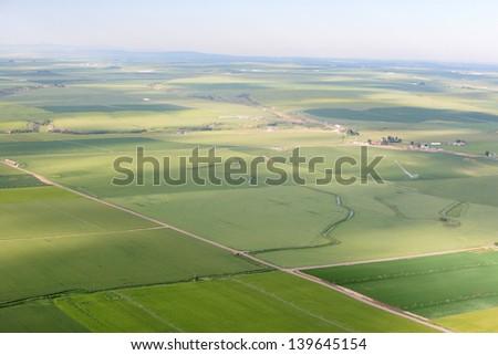 An aerial view of rural farmland. - stock photo