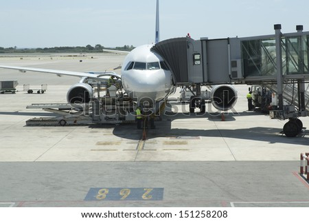 an aeroplane getting ready for takeoff in barcelona airport - stock photo