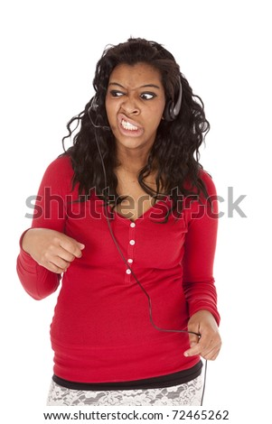 An African american business woman with a head set is mad. - stock photo