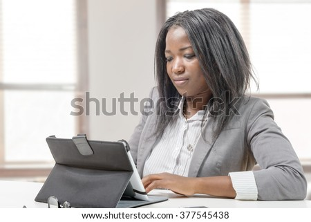 an African american business woman working with tablet - stock photo