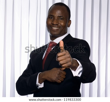 An african american businessman showing ok
