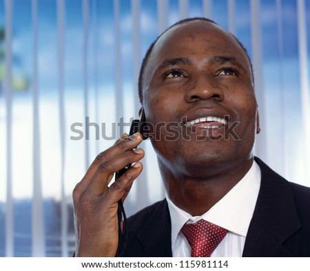 An african-american businessman talking on the phone - stock photo
